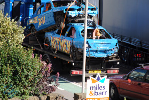 Sunday Photo Fiction - two wrecked cars on a carrier