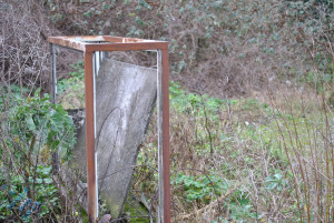 an old busted metal frame in the woods