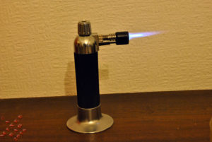 A culinary torch sitting on a table
